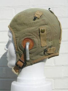 fbdb30c3a3d Left  A-9 summer flight helmet with R-14 recievers held in place by supple  ear pockets